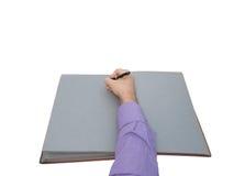 在开放老笔记本的手文字 库存图片