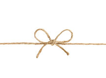 在弓或麻线栓的串隔绝在白色 免版税库存照片