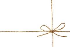 在弓或麻线栓的串隔绝在白色 免版税库存图片
