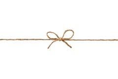 在弓或麻线栓的特写镜头串隔绝在白色 免版税库存照片