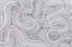 在弯曲的纸的墨水排行背景 免版税库存照片