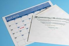 在归档的税的明信片信封1040简化的形式 库存图片