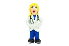 在彩色塑泥做的友好医生妇女微笑 免版税库存图片