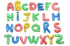 在彩色塑泥外面的字母表 库存图片