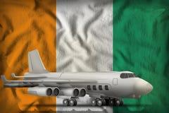 在彻特d Ivoire状态旗子背景的轰炸机 3d例证 皇族释放例证