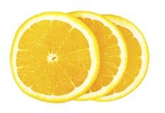 在彼此堆积的三个橙色切片 免版税图库摄影