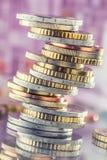 在彼此堆积的欧洲硬币用不同的位置 金钱c 免版税库存照片