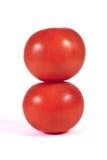 在彼此的两个红色蕃茄宏指令或关闭隔绝了 库存图片