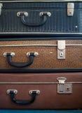 在彼此顶部的三个老手提箱 图库摄影