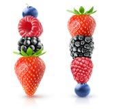 在彼此顶部的被隔绝的莓果 免版税库存图片