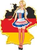 在德国地图的年轻和美丽的巴法力亚女孩 免版税库存照片