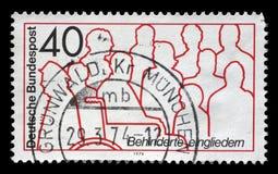 在德国打印的邮票致力了残疾的综合化 图库摄影