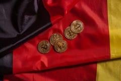 在德国旗子的金黄bitcoins 库存图片
