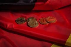 在德国旗子的金黄bitcoins 免版税库存照片