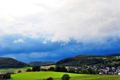 在德国的兹瓦本地方白长袍的高度的雷暴 库存照片