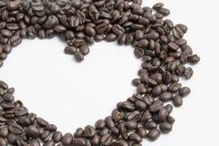 在心脏形状的咖啡豆 库存照片