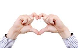 在心脏形状的手 免版税库存照片