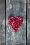 在心脏形状的石榴种子 库存图片