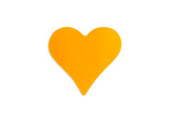 在心脏形状的空白的橙色便条纸 库存图片