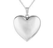 在心脏形状的银色垂饰 免版税图库摄影