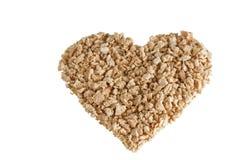 在心脏形状的织地不很细大豆蛋白粒子  库存图片