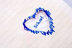 在心脏的形式做的在纸孔 免版税图库摄影