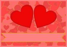 在心脏背景的两红色心脏 免版税库存图片