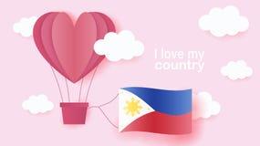 在心脏飞行形状的热空气气球在云彩的与菲律宾国旗  纸艺术和裁减,充满爱的origami样式 皇族释放例证