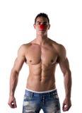 在性感的年轻热的人鼻子的小红色球作为小丑 免版税库存照片