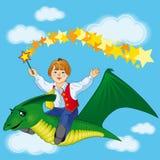 在恐龙的男孩飞行 图库摄影