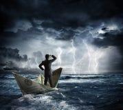 在恶劣天气的美元小船 库存图片