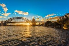 在悉尼港桥悉尼澳大利亚的日落 免版税库存图片
