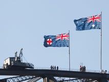 在悉尼港桥的旗子 图库摄影