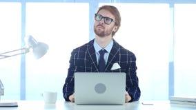 在想法丢失的红头发人商人,计划的新的想法 免版税库存图片