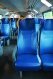 在意大利现代火车里面的空位 图库摄影
