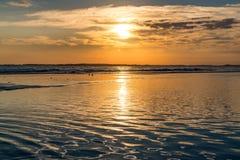 在愚蠢海滩的日落 免版税库存图片