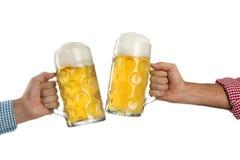 在慕尼黑啤酒节的欢呼在白色背景前面 库存图片