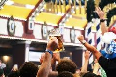 在慕尼黑的慕尼黑啤酒节的啤酒斯坦 库存照片