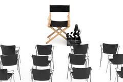 在戏院Chair,电影拍板a主任前面的办公室椅子 免版税库存照片