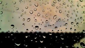 在我的窗口的雨珠 库存图片
