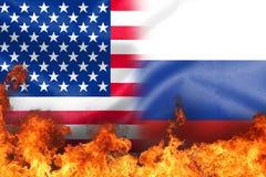 在我们和俄罗斯旗子的火焰 免版税库存照片