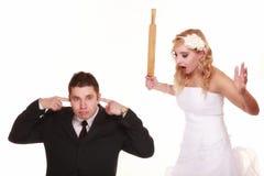 在战斗的婚礼夫妇,相冲突坏关系 库存照片