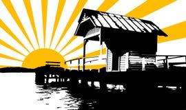 在房子后的太阳光芒 库存图片