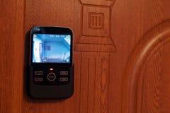 在房子的前门的录影电话registrator 免版税库存照片