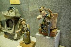 在房子的屋顶使用的装饰品,由陶瓷图做成由广东,夫斯汉,石湾 免版税库存照片