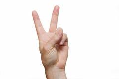在手上的两个手指在上面被舒展 图库摄影