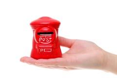 在手上的红色玩具岗位箱子 库存图片