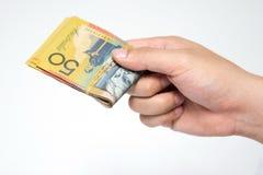 在手中关闭五十个澳大利亚美元金融法案  库存照片