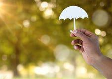 在手中删去伞和自然 库存图片