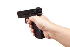 在手中开枪和指向,隔绝在白色背景 库存图片